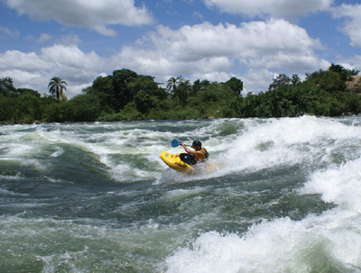 Surfing the 'Nile Special' on the White Nile in Uganda